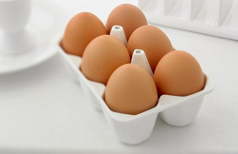 Close up six eggs in carton